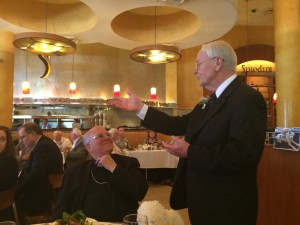 Br. John Dodd speaks to well wishers, including Las Vegas Bishop Joseph Pepe, left, at his retirement luncheon