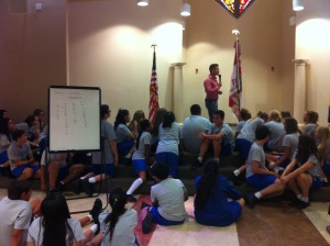 Inspirational speaker, James Silvas, addresses eighth graders during an opening retreat