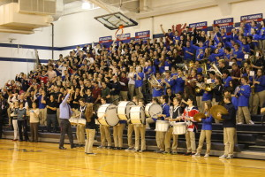 Saint Viator High School Band Director Vince Genualdi leads the band in playing the school's fight song at a 2015 pep rally