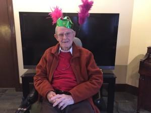 Fr. Frank White, 97, enjoys the Mardi Gras party