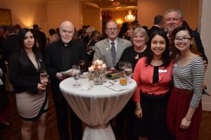 Fr. John Milton, Br. Dan Lydon, and Associates Tim and Donna Schwarz enjoy visiting with students