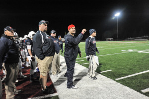 Fr. Dan Hall, far left, coaching on the sidelines