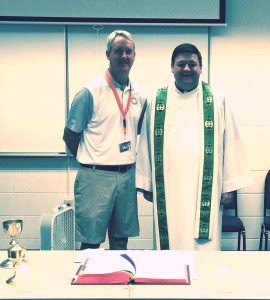 Brian McCaskey of the Chicago Bears poses after Mass with Fr. Jason Nesbit