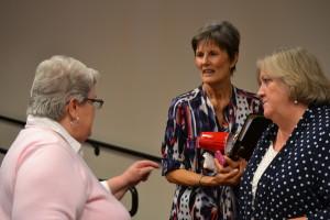 Associates Marilyn Mulcahy, Connie Gerber and Donna Schwarz make their points