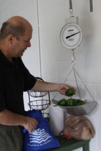 Pre-Associate John Dussman weighs some of his harvest