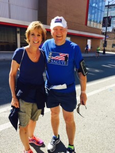 Fr. Dan Hall, pausing at Mile 17 of the Chicago Marathon with one of his fans, Saint Viator High School Registrar, Rose Ruffatto