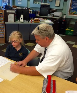 Br. Dan Tripamer, CSV, helps a student with math homework
