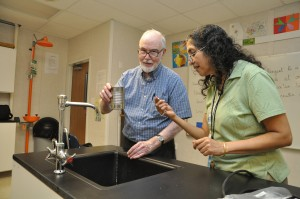 Fr. John Milton develops physics experiments with Ms. Kumkum Bonnerjee at Cristo Rey St. Martin College Prep