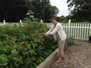 Associate Joan Sweeney cuts some of her flowers