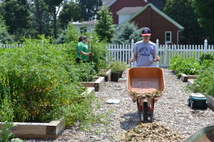 Saint Viator High School students completed service hours in the garden