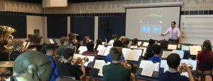 Mr. Vince Genualdi uses technology to help members in Saint Viator's band tune their instruments