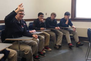 Saint Viator students ask questions during a master class