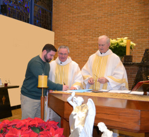 Novice Br. Peter Lamick accepts the conditions of entering the novitiate before Fr. Thomas von Behren, provincial, and Fr. John Van Wiel, his novice director