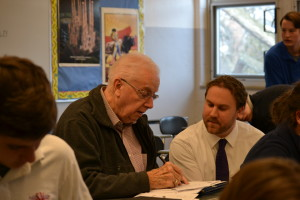 Mr. Kurt Paprocki, right, works with his newest freshman, Fr. Charles Bolser