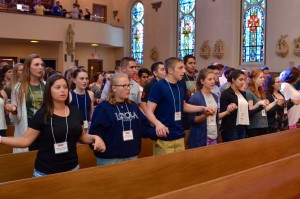 Meredith, fourth from left, participates in a daily Mass during VYC
