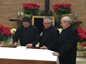 Br. Peter Lamick signs his vows before Fr. Thomas von Behren, provincial, and Fr. Arnold Perham, assistant novice director