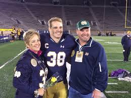 Notre Dame linebacker, Joe Schimdt, with his parents, Debra and Joe on senior day