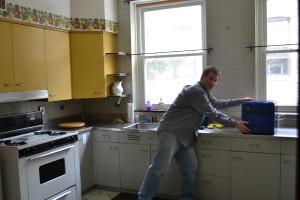 Br. Michael Gosch works to set up the kitchen