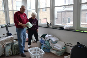 Viatorian Associates Randy Baker and Gerry Roller unpack linens for the House of Hospitality