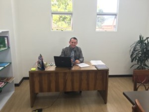 Br. William Pardo, CSV, director of the Diploma Program in his office