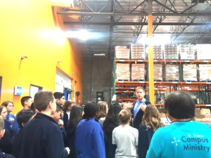 Students tour the massive food distribution warehouse