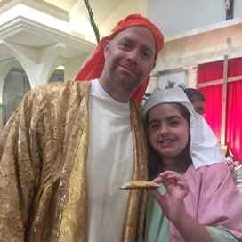Associate Paul Hartz portrayed one of the disciples, appearing here with his daughter