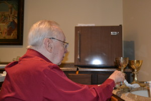 Br. Don Houde, CSV, lovingly polishes a pair of chalices to be donated