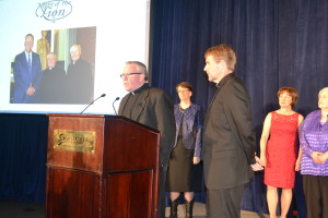 Fr. Thomas von Behren, CSV, thanks Fr. Corey Brost, CSV, for his leadership as president of Saint Viator High School