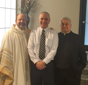 Fr. Dan Belanger, CSV, left and Fr. Richard Pighini, CSV, right congratulate Terry Granger on being named Principal of the Year