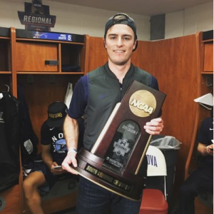 Matt O'Neill with the NCAA men's basketball championship trophy in the Villanova locker room