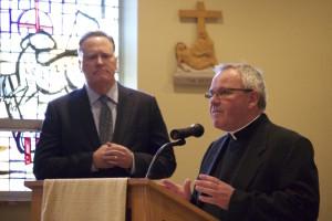 Fr. Thomas von Behren, CSV, introduces Mr. Brian Liedlich as the next president of Saint Viator High School