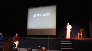 Steen Metz presenting at Saint Viator High School, with his granddaughter, Sarah McDermott '19, helping with slides