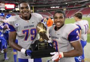 Ronnie Stanley and his Bishop Gorman teammate, Shaq Powell, hold up the state trophy
