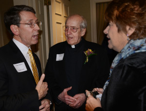 Fr. Arnold Perham, CSV, center, with Arlington Heights Mayor Tom Hayes, left, and Saint Viator Principal Eileen Manno at the Hearts of Gold dinner in 2015.