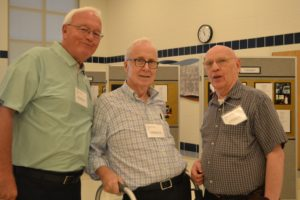 Fr. William Haesaert, left, Fr. Robert Bolser, center, and Fr. John Eck enjoy catching up