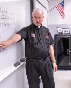 Fr. John Van Wiel taught chemistry at Saint Viator High School for 25 years