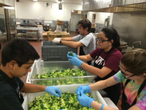 Teens from St. Thomas More help prepare food for Catholic Charities at the 2015 Camp LIGHT