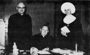 Fr. Ed Anderson, CSV, center, joined the administrative team at Bishop Gorman High School in 1966, with Fr. Philip Clifford, CSV, left, and Sr. Irmalyn, CSV, vice principal