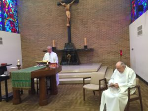 Fr. Simon Lefebvre, left, and Fr. James Crilly, right, concelebrate their 60th jubilee Mass