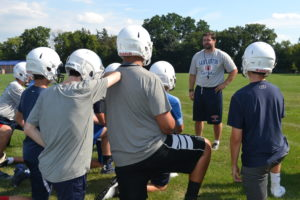 Br. Peter Lamick gives a pep talk to some of the freshmen team