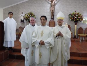 Fr. Thomas von Behren, left, Br. Fredy Contreras, center and Msgr. Misael Vacca Ramirez, right