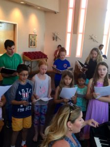 The children's choir at St. Thomas More gets underway