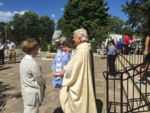 Fr. Richard Pighini, CSV, pastor, meets with parishioners after the dedication