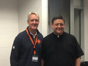 Fr. Jason Nesbit with Brian McCaskey of the Chicago Bears front office, after saying Mass at training camp