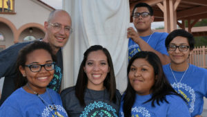 Daisy Morales, center, with VYC delegates in 2014, and delegation leader, Jim Dippold, upper left