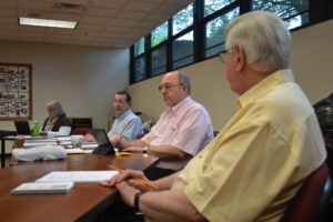 Fr. Lawrence Lentz, CSV, right, at a meeting of the Viatorian Community Council