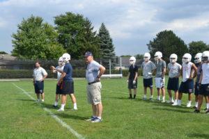 Fr. Hall runs the special teams through their drills