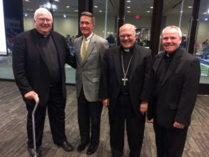 Fr. Thomas von Behren, CSV, right, appears with (L-R) Fr. John Foley, S.J., John Killduff, and Bishop Joseph Pepe at the Oct. 5 news conference