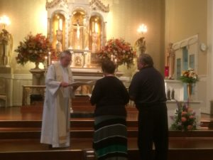 Fr. Thomas von Behren accepts the definitive commitments of Associates Michelle and Ken Barrie