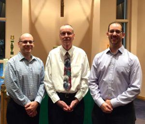 Associate Brian Barrett, right, with Associates John Keating, left, and Don Wells, center, during their re-commitment ceremony in 2015